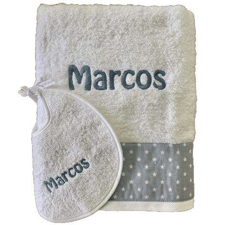 Conjunto toalla y babero bordado personalizado tela azul estrellas blancas